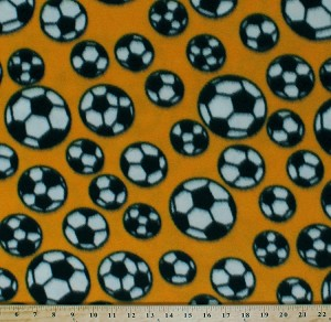 Fleece (not for masks) Soccer Balls Tossed Soccerballs on Yellow Sports Fleece Fabric Print by the Yard s0415g