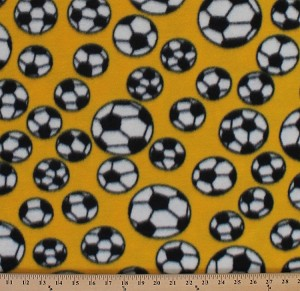 Fleece (not for masks) Soccer Balls Tossed Soccerballs on Yellow Sports Fleece Fabric Print by the Yard smfp300-c5h